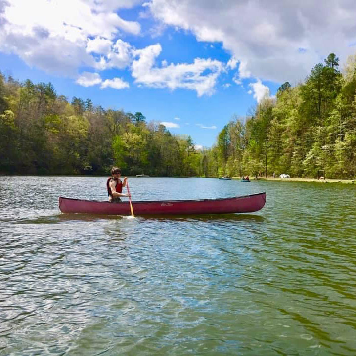 A student at Black Mountain Academy Canoes in a lake